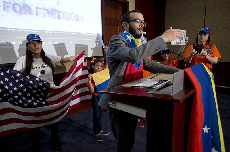 In this May 9, 2014 file photo, Gabriel Jimenez addresses Venezuelan-Americans during an event to pressure the Obama administration to implement sanctions on the government of Nicolas Maduro on Capitol Hill in Washington. (AP Photo)