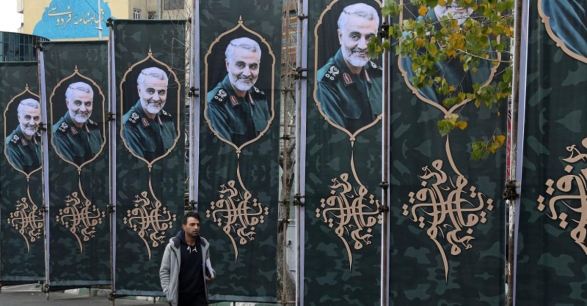 A pedestrian walks past banners showing portrait of Iranian Revolutionary Guard Gen. Qassem Soleimani, who was killed in a U.S. airstrike early Friday in Iraq, in Tehran, Iran, Saturday, Jan. 4, 2020. (AP Photo)