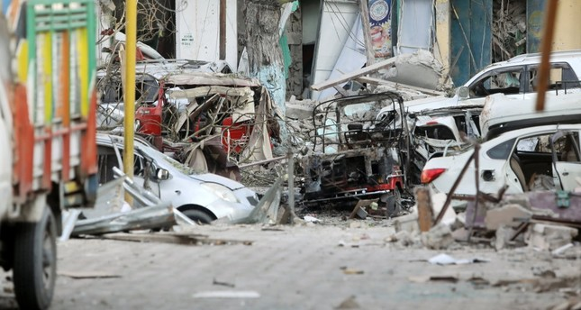 Damaged cars are seen at the scene where a suicide car bomb exploded in Maka Al Mukaram street in Mogadishu, Somalia March 1, 2019.