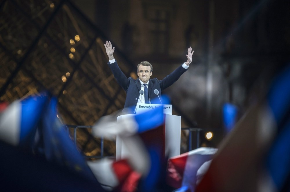 Emmanuel Macron celebrating on stage after winning the second round of the French presidential elections at the Carrousel du Louvre in Paris, May 7.