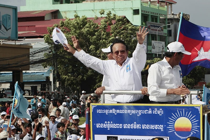 In this June 2, 2017, file photo, opposition party Cambodia National Rescue Party (CNRP) leader Kem Sokha greets his supporters at a rally in Phnom Penh. (AP Photo)