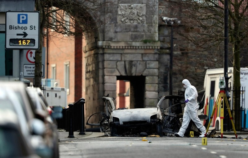 Forensic investigators at the scene of a car bomb blast on Bishop Street in Londonderry, Northern Ireland, Sunday, Jan. 20, 2019.  (Niall Carson/PA via AP)