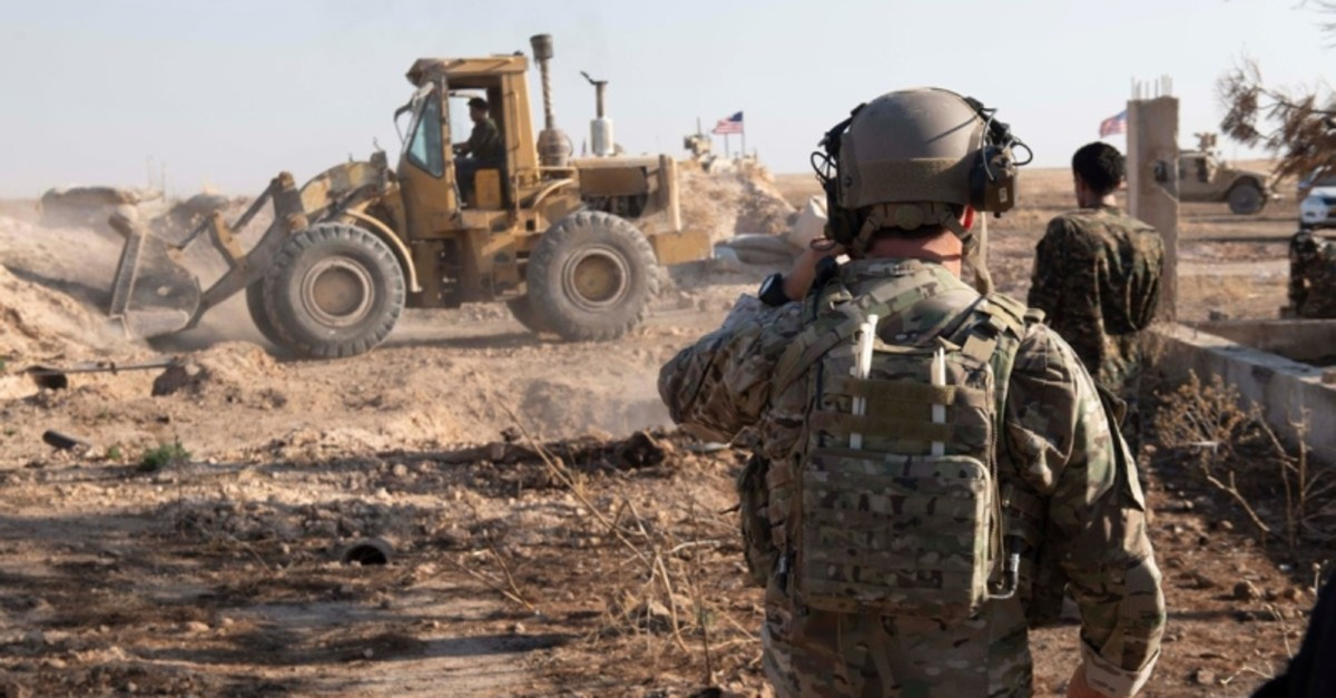 This file photo dated Aug. 23, 2019 and provided by the US Central Command Twitter account (@CENTCOM) shows military fortifications of the SDF being removed.