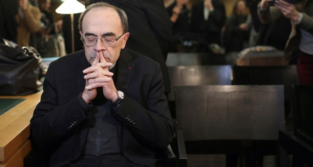 Cardinal Philippe Barbarin waits for the start of his trial at the Lyon courthouse, central France, Monday Jan. 7, 2019. (AP Photo)