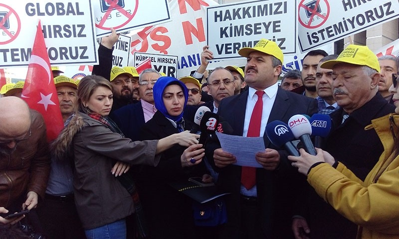 Taxi drivers give a press statement against Uber in front of the Istanbul Grand Courthouse in u00c7au011flayan neighborhood, March 12, 2018. (DHA Photo)