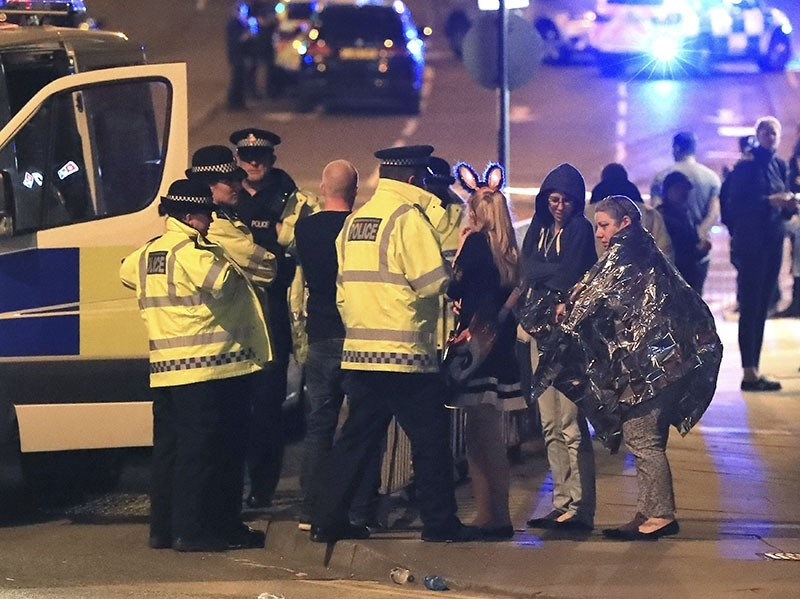 This is a May 23, 2017 file photo of members of the  emergency services attending the scene at Manchester Arena after reports of an explosion at the venue during an Ariana Grande gig. (Peter Byrne/PA, File via AP)
