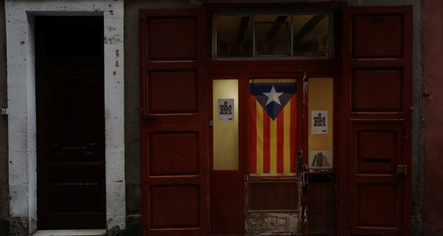 An Estelada (Catalan flag) hangs from a door, Barcelona, Oct. 4.