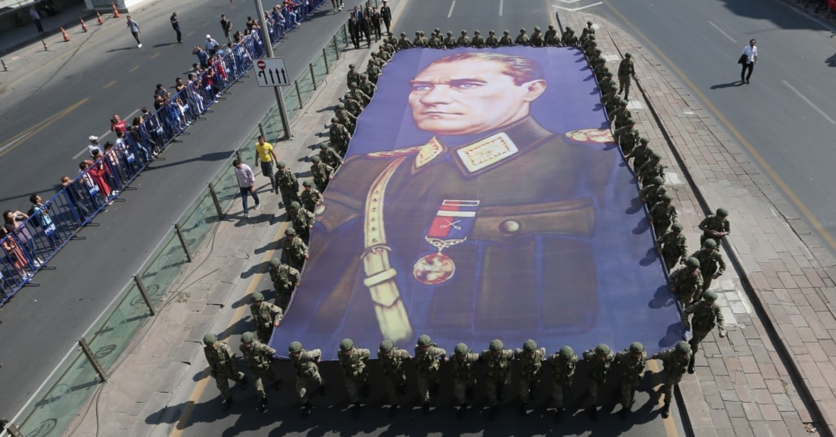 Soldiers carry a giant portrait of Mustafa Kemal Atatu00fcrk during a Victory Day parade in Ankara, Aug. 30, 2019.
