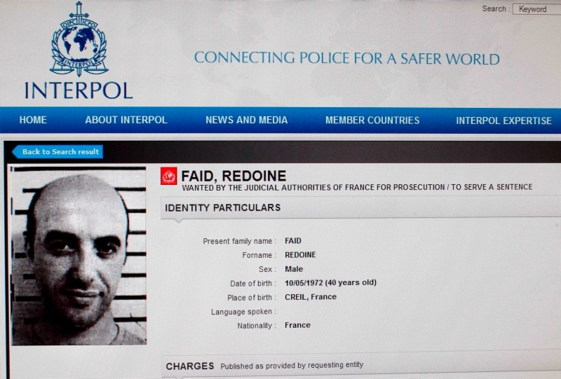 This file photo shows a reproduction of the Interpol website made on April 15, 2013 in Paris showing the international wanted person notice for Redoine Faid. (AFP Photo)