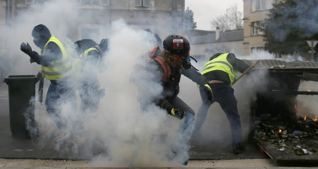 French police fire tear gas as yellow vest demonstrators set up barricades in Bourges, Jan. 12, 2019.