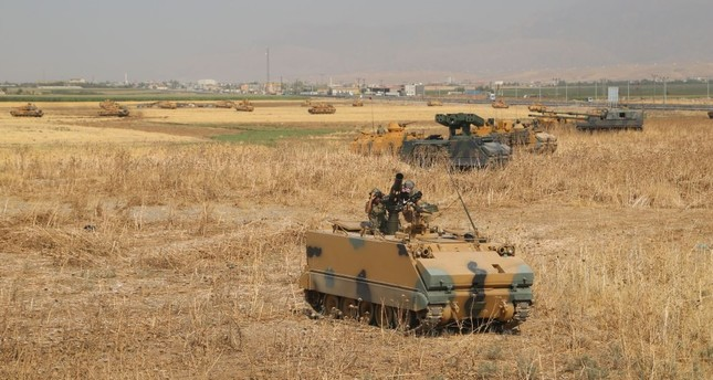 Turkish armored vehicles near the Habur crossing gate between Turkey and Iraq during a military drill on Sept. 18.
