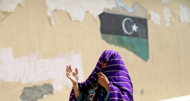 A displaced Libyan woman reacts to clashes between rival groups, Tripoli, April 14, 2019.