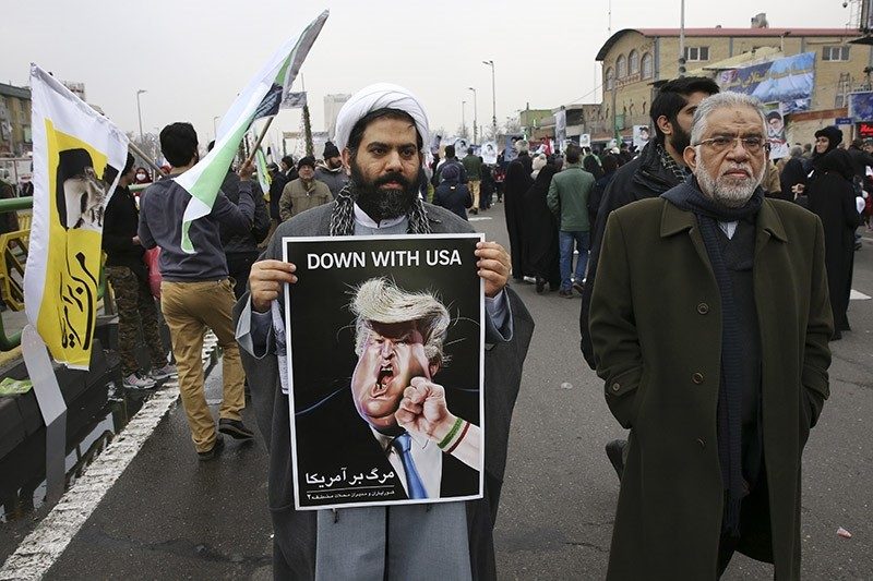 An Iranian man holds a caricature of U.S. President Donald Trump in an annual rally commemorating the anniversary of the 1979 revolution which toppled the late pro-U.S. Shah in Tehran, Iran on Feb. 10, 2017. (AP Photo)