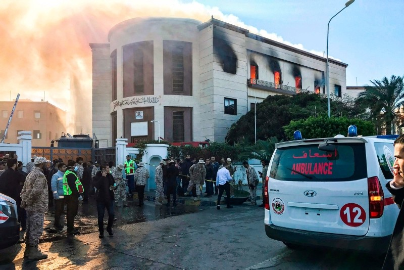 A picture taken on December 25, 2018 shows ambulances, paramedics, and security officers at the scene of an attack outside the Libyan foreign ministry headquarters in the capital Tripoli. (AFP Photo)