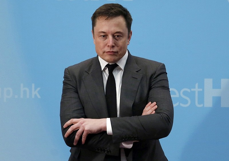 Tesla Chief Executive Elon Musk stands on the podium as he attends a forum on startups in Hong Kong, China Jan. 26, 2016. (Reuters Photo)