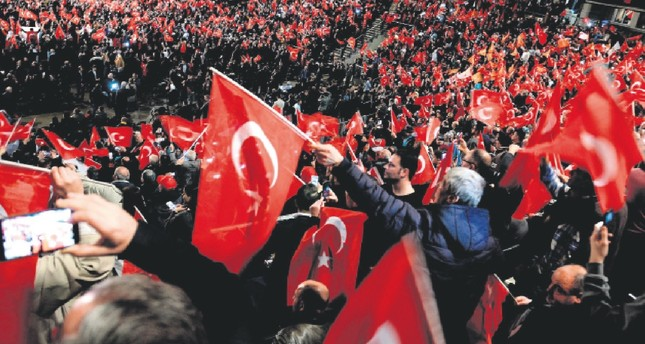 Participants wave Turkish flags peacefully during a meeting held in Germany by Turkish Prime Minister Binali Yıldırım in Oberhausen, Feb. 18, 2017.