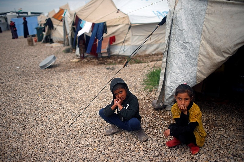 Displaced Iraqis sit outside their tent during the visit of United Nations Secretary General Antonio Guterres at Hasansham camp, in Khazer, Iraq March 31, 2017. (Reuters Photo)