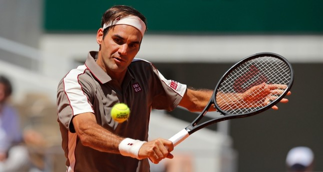Switzerland's Roger Federer plays a shot against Argentina's Leonardo Mayer during their fourth round match of the French Open tennis tournament at the Roland Garros stadium in Paris, Sunday, June 2, 2019. (AP Photo)