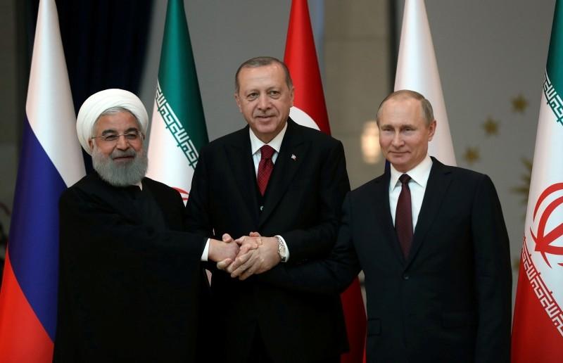 Presidents Hassan Rouhani of Iran, Tayyip Erdogan of Turkey and Vladimir Putin of Russia pose before their meeting in Ankara, Turkey, April 4, 2018. (Reuters Photo)