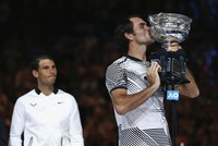Roger Federer defied age and his Grand Slam nemesis Rafael Nadal to win a record 18th Grand Slam title in a thrilling, five-set final at the Australian Open on Sunday.