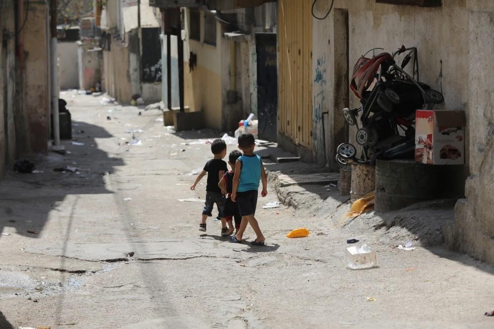 Palestinian refugee children walk in a street in Askar refugee camp near the West Bank city of Nablus, Sept. 2.