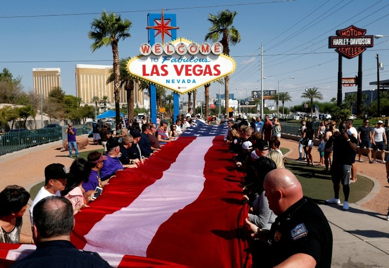 First responders and others fold an American flag following a prayer service during the one-year anniversary of the October 1 mass shooting, in Las Vegas, Nevada, U.S. October 1, 2018. (REUTERS Photo)