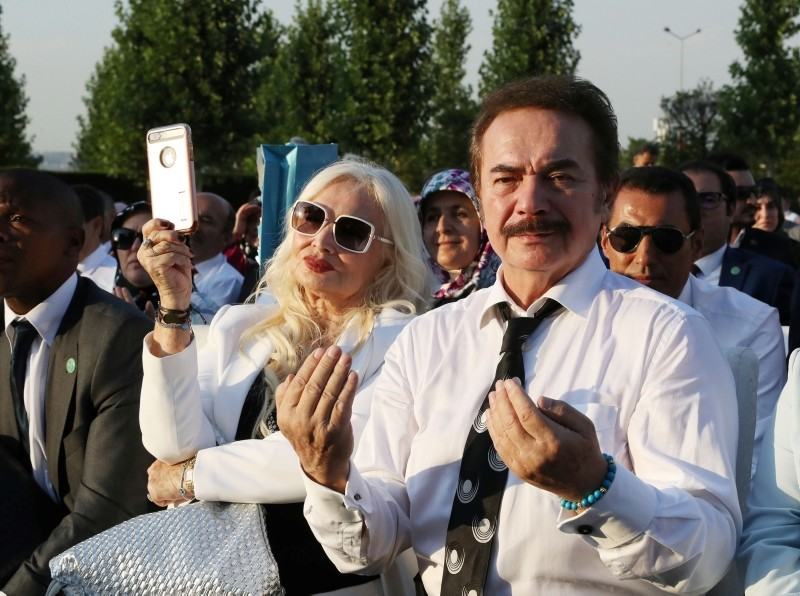 Turkish musician Orhan Gencebay and his wife Sevim Emre attend a ceremony for Erdoğan in Ankara.