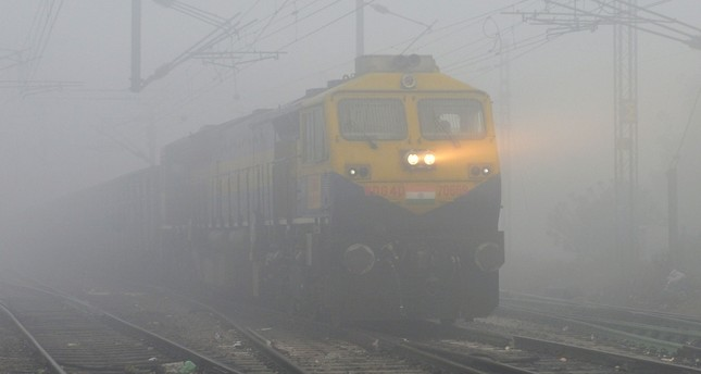 A train travels in dense fog in Jalandhar on December 25, 2018 (AFP Photo)