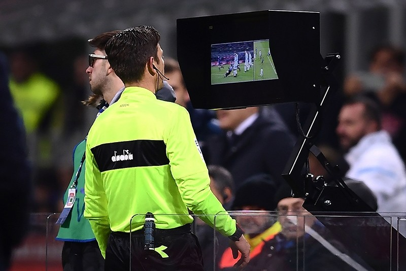 In this Dec. 30, 2017 file photo referee, Gianluca Rocchi is looking at the screen of the Video Assistant Referee (VAR) system during the Italian Serie A football match Inter Milan vs Lazio at the San Siro Stadium in Milan, Italy. (AFP Photo)