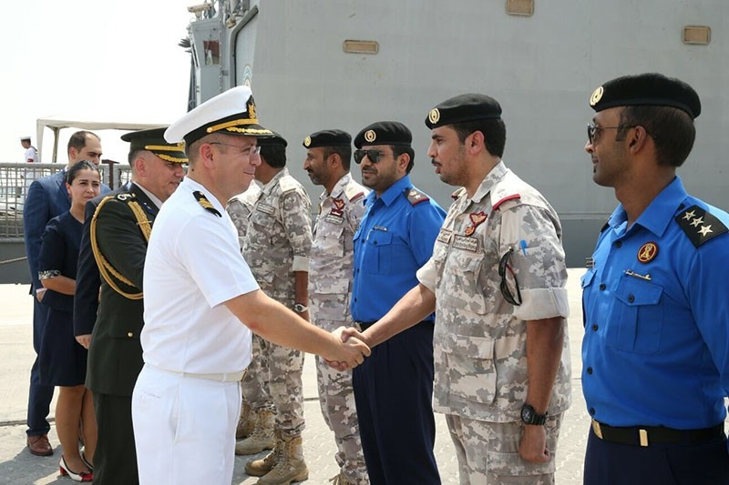 Turkish military officers shake hands with their Qatari counterparts at Hamad Port near Doha, Qatar, August 1, 2017 (AA Photo)