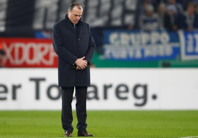 Clemens Toennies, president of German's first division Bundesliga soccer club Schalke 04 stands on the pitch during a minute of silence for late team manager Rudi Assauer at the Veltins Arena in Gelsenkirchen, Germany, February 6, 2019. Reuters