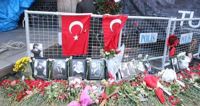 Flowers, Turkish flags and photos of victims on and around police barriers outside the Reina nightclub.