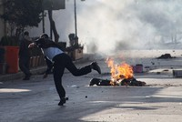 Buildings torched as protests sweep Iraq's KRG