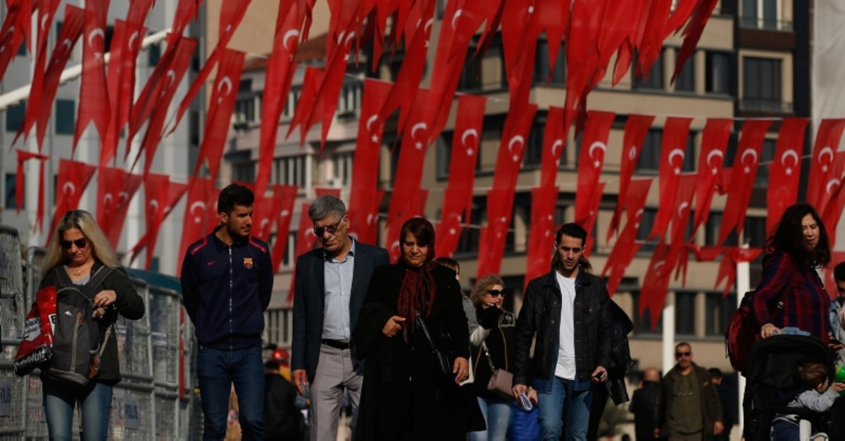 People walk in Taksim Square in Istanbul, Turkey on Tuesday, Nov. 19, 2019.  (AP Photo)