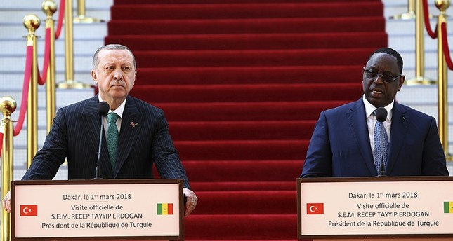 President Recep Tayyip Erdoğan, left, and Senegal's President Macky Sall speak during a joint news conference after talks in Dakar (AP Photo)