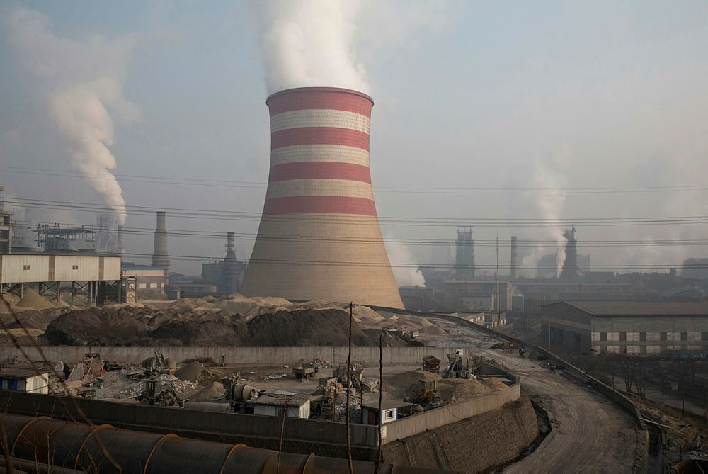Smoke and steam spew from the sprawling complex that is a part of the Jiujiang steel and rolling mills in Qianan in northern China's Hebei province.  (AP Photo)
