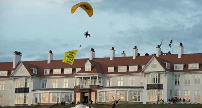 In this Friday, July 13, 2018 photo, a Greenpeace protester flying a microlight passes over US President's Donald Trump's resort in Turnberry, South Ayrshire, Scotland. (AP Photo)