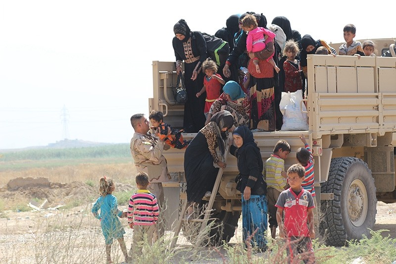 Iraqi's flee from the Havice district of Kirkuk after Daesh attacked their village. (AA Photo)
