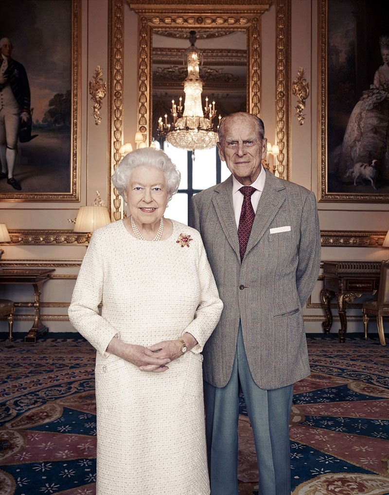 In this handout photo issued by Camera Press and taken in Nov. 2017, Britain's Queen Elizabeth and Prince Philip pose for a photograph in the White Drawing Room at Windsor Castle, England. (Matt Holyoak/Camera Press via AP)