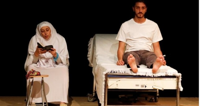 Actors perform during a rehearsal of the play called While I Was Waiting, at Dawar al-Shams theatre in Beirut, Lebanon.