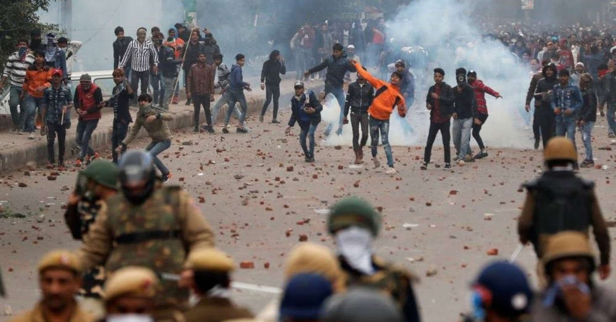 Demonstrators throw pieces of bricks toward riot police during a protest against a new citizenship law in Seelampur, Delhi area, India, Dec. 17, 2019. (Reuters Photo)