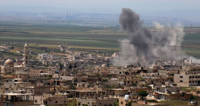 Smoke billows following intense shelling in Khan Sheykun in Syria's Idlib province, May 10, 2019.