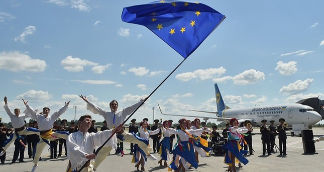 troupe of Ukrainian dancers perform on the tarmac at Boryspil airport in Kiev on June 11, 2017 on the first day of visa-free travel for Ukrainian nationals to the European Union AFP Photo