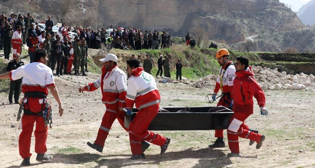 Red Crescent workers carry the body of a victim from the plane crash site. All victims were friends of Mina Başaran (R) who hosted a bachelorette party in Dubai ahead of her wedding in April.