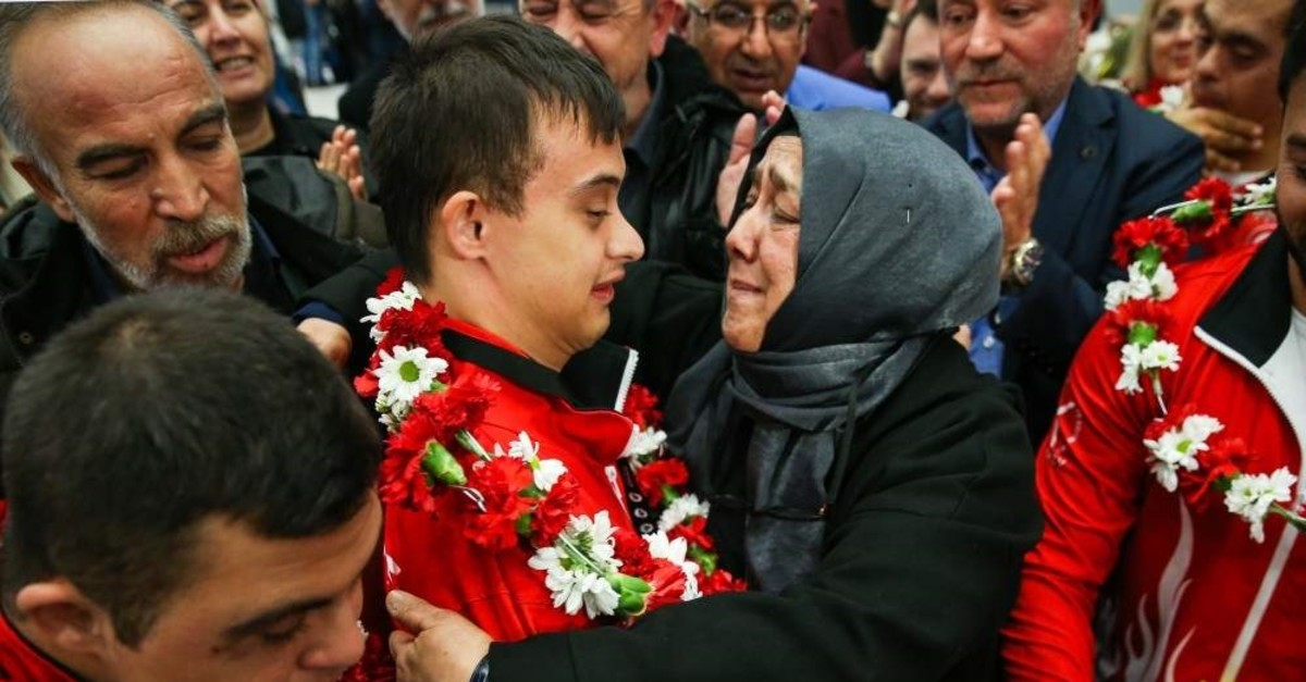 Semiha Erdem hugs her son Talha Ahmet Erdem at the airport as he returns from Portugal after winning gold, Dec. 2, 2019. (AA Photo)