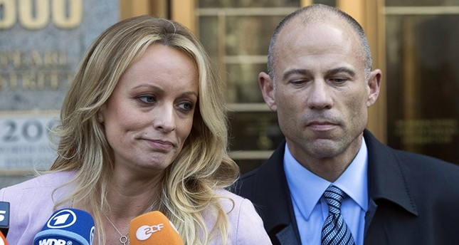 In this April 16, 2018, file photo, adult film actress Stormy Daniels, left, stands with her lawyer Michael Avenatti as she speaks outside federal court in New York. (AP Photo)