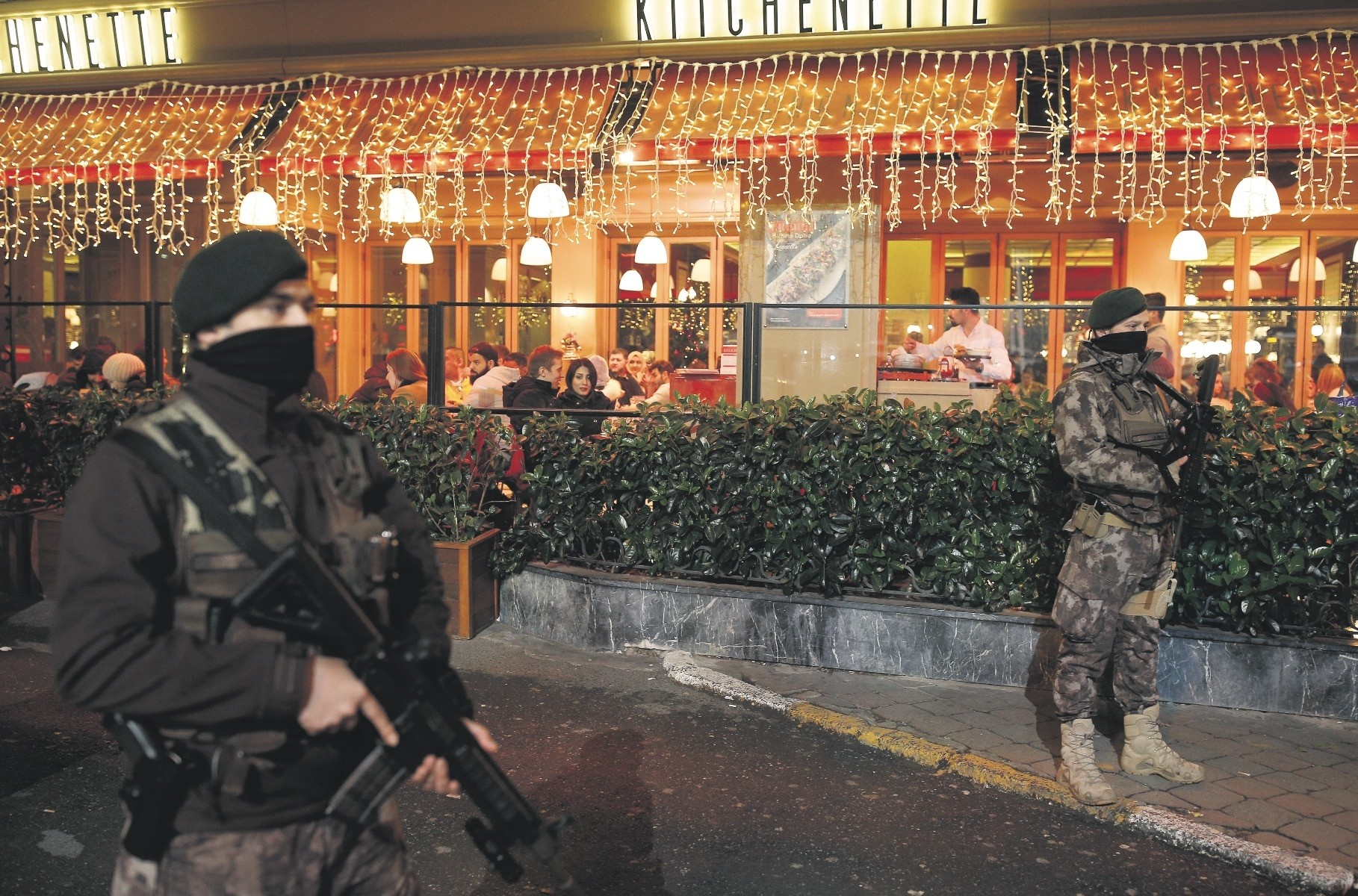 Special Operations police stand outside a restaurant at Istanbulu2019s Taksim Square during New Yearu2019s Eve. Security measures were stepped up across the city after a Daesh militant killed 39 people at a nightclub in the early hours of Jan. 1, 2017.