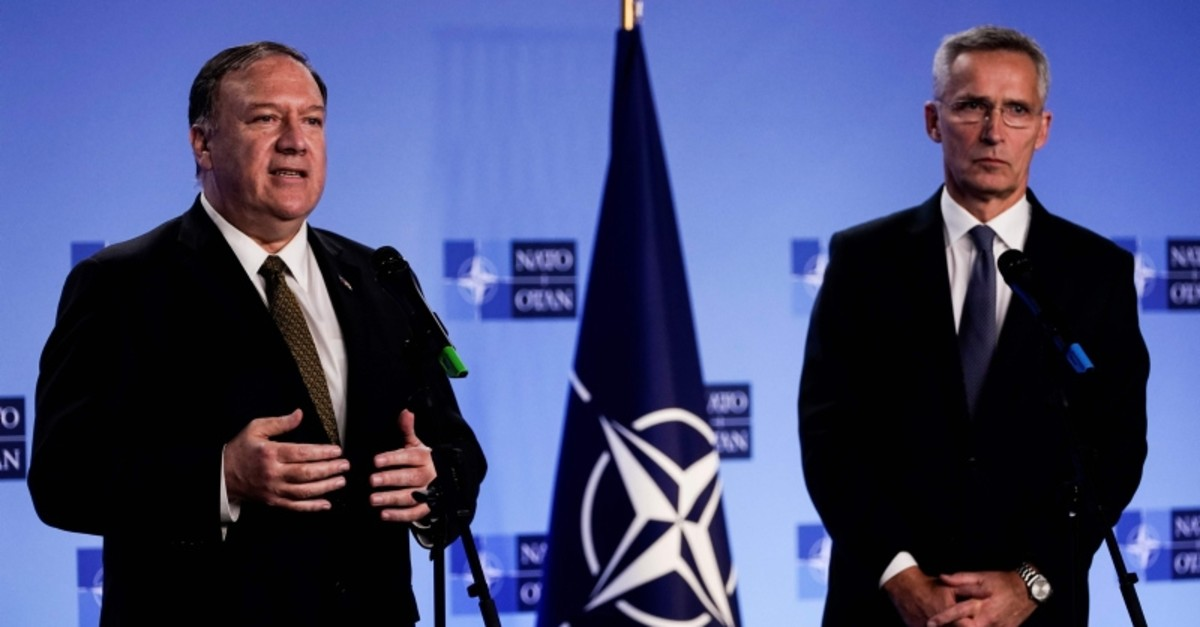 US Secretary of State Mike Pompeo (L) gestures as he delivers a speech during a joint press conference with NATO Secretary General Jens Stoltenberg following their meeting in Brussels, on Oct. 18, 2019 (AFP Photo)