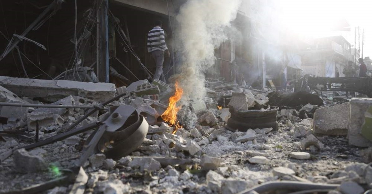 People check the destruction after a car bomb exploded by PKK-linked People's Protection Units (YPG) terrorists in Tal Abyad, Syria, Nov. 2, 2019.