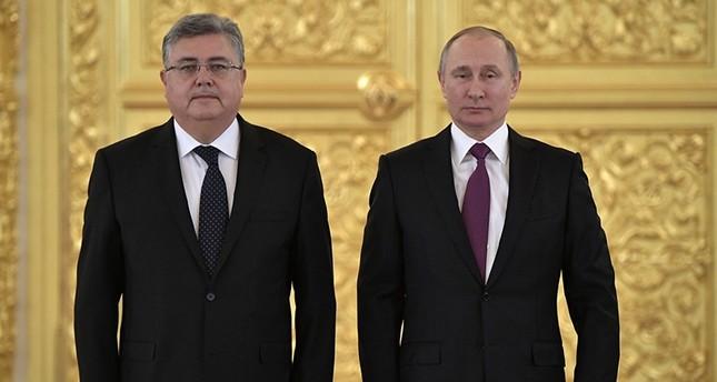 بوتين أثناء استقباله السفير التركي حسين ديري أوز